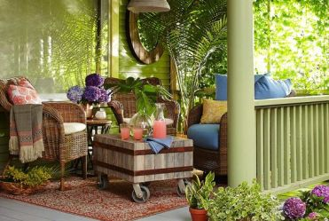 1-a-tropical-boho-porch-with-woven-furniture-a-wooden-coffee-table-potted-greenery-and-colorful-textiles
