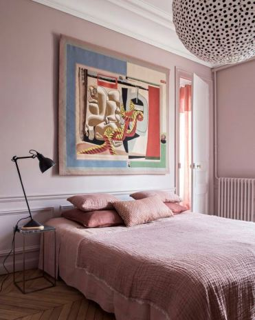 2-04-a-chic-bedroom-with-light-pink-walls-pink-bedding-and-a-statement-artwork-and-a-polka-dot-lamp-1