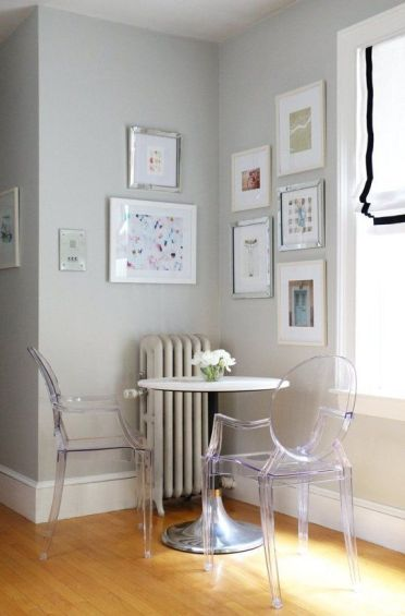 2-16-a-small-breakfast-space-with-a-round-table-and-acrylic-chairs-looks-airy-and-very-comfy