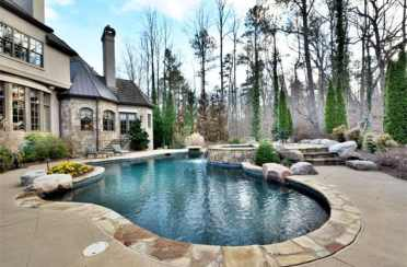 2-mountain-pond-swimming-pool-design-with-rock-border-and-spa