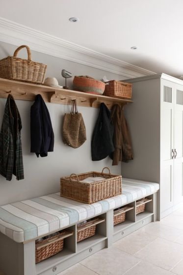 20-a-bench-with-a-striped-mattress-on-top-and-some-woven-baskets-as-drawers-inside