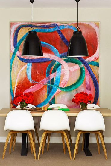 3-it-is-the-art-piece-that-sets-the-mood-in-this-dining-room-1