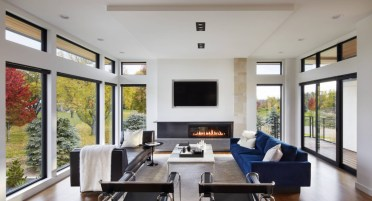 Modern-family-room-with-fireplace-and-lots-of-windows