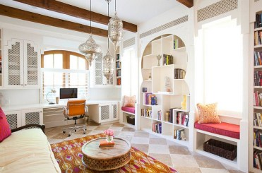 Multiple-architectural-details-curved-doorways-and-moroccan-inspired-lights-shape-this-living-room