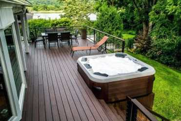 Brown-stained-wood-backyard-hot-tub-deck-design-1