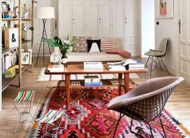 Ethnic-rug-in-living-room-interior-design-wall-shelves