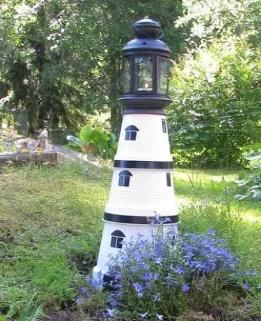 Painted-clay-pot-yard-lighthouse-idea