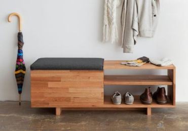 02-a-modern-wooden-shelf-with-a-drawer-under-the-seat-and-open-shelving-is-used-as-a-bench