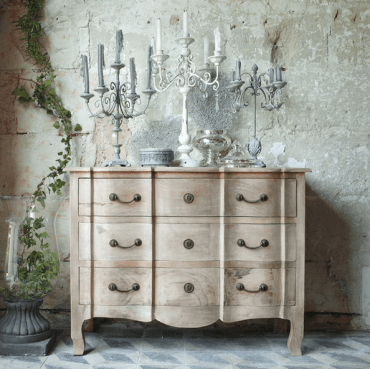 02-beautiful-light-colored-wood-vintage-dresser-with-antique-candle-holders