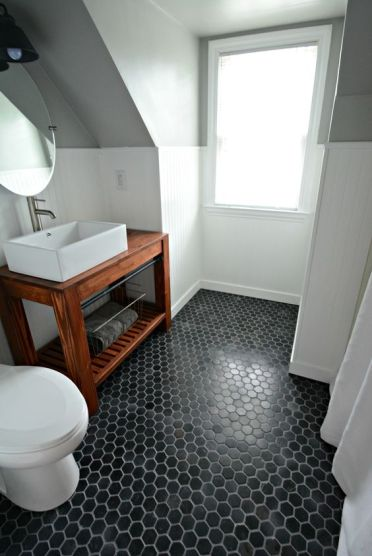 03-black-hex-tiles-make-a-statement-in-this-neutral-bathroom