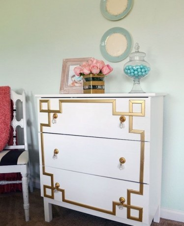 19-a-vintage-inspired-tarva-dresser-with-gold-inlays-and-gold-and-crystal-pulls-for-a-touch-of-art-deco