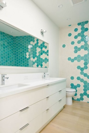 2-02-cream-and-turquoise-hex-tiles-on-the-wall-create-a-bold-mosaics-that-makes-the-space-unique-and-eye-catching