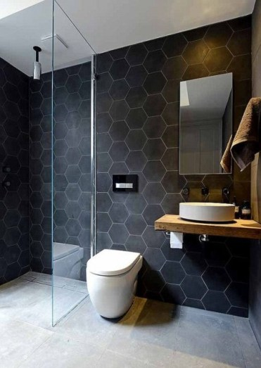 2-03-large-scale-matte-black-hexagon-tiles-with-white-grout-make-the-walls-bold-and-outstanding