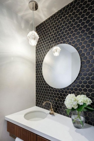 2-04-small-black-hex-tiles-with-brass-grout-and-a-matching-faucet-to-create-an-elegant-and-refined-look-in-the-sink-zone