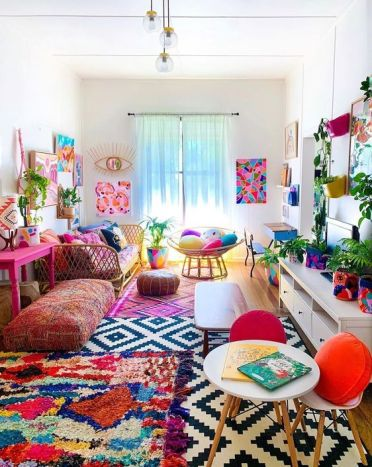 2-a-colorful-boho-living-room-with-a-bright-gallery-wlal-colorful-rugs-and-pillows-potted-greenery-and-florals-is-summer-like