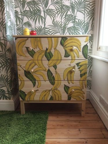 Ikea-tarva-hack-with-painted-bananas-andgold-knobs-is-a-playful-and-whimsy-item-for-storage