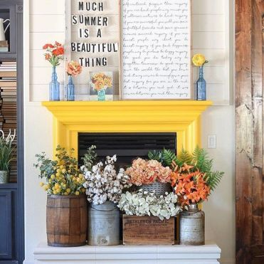A-couple-of-signs-bright-blooms-in-vases-and-lush-floral-arrangements-in-crates-and-churns-for-summer-decor