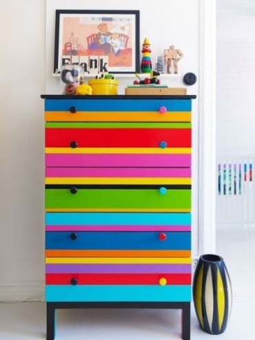 Colorful-striped-tarva-dresser-hack-with-bold-knobs-is-a-fun-and-whimsy-piece-ideal-for-a-kids-room