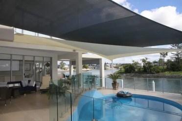 Outdoor-swimming-pool-design-ideas-sun-shade-patio-sail-awning