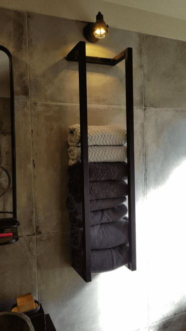 12-an-industrial-black-metal-wall-mounted-shelf-with-various-towels-and-a-light-over-it-is-a-stylish-idea-to-store-stuff