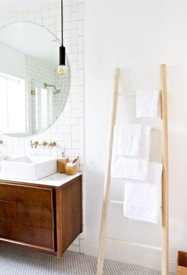 23-a-simple-wooden-ladder-with-some-towels-is-a-cool-space-saving-towel-storage-idea-for-every-kind-of-bathroom