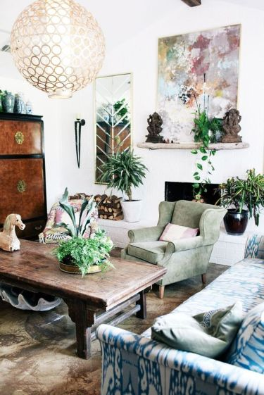 39-a-bright-eclectic-living-room-with-pastel-living-room-a-fireplace-potted-greenery-and-a-sphere-chandelier
