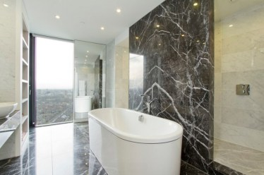 Bathroom-with-marble-walls-and-flooring