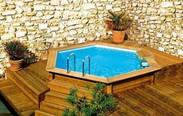 Above-ground-pools-with-decks-small-garden-pool-stone-wall-wooden-deck