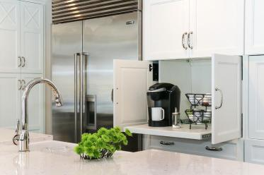 Benjamin-moore-simply-white-kitchen-cabinets-hidden-pull-out-coffee-station