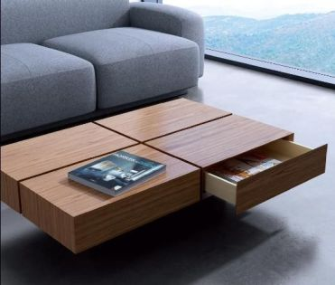 02-a-coffee-table-that-features-four-drawers-for-storage-and-a-cool-laconic-look