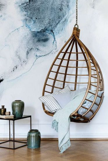 03-a-rattan-hanging-chair-can-make-a-bold-statement-in-any-modern-space