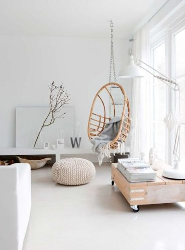 04-a-rattan-hanging-chair-on-a-chain-makes-the-interior-warmer