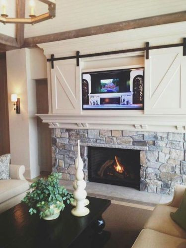 1-barn-doors-for-a-wall-mounted-tv-above-the-fireplace