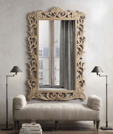 15-a-mirror-in-a-carved-wooden-frame-with-vignettes