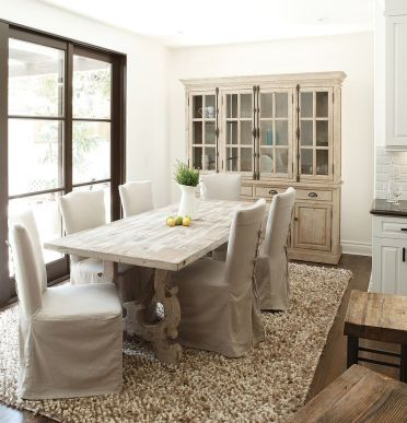 French-country-style-dining-room-with-a-stylish-hutch-and-dining-table-in-wood
