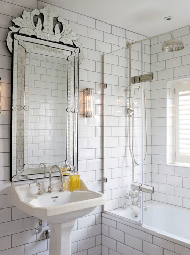 Half-glass-wall-in-transitional-bathroom-with-a-pedestal-sink