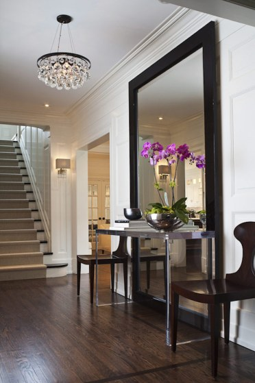 Large-full-length-mirror-with-table-and-chairs-in-entryway