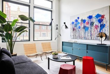Tiny-scandinavian-style-living-room-with-gray-couch-and-blue-credenza-35240