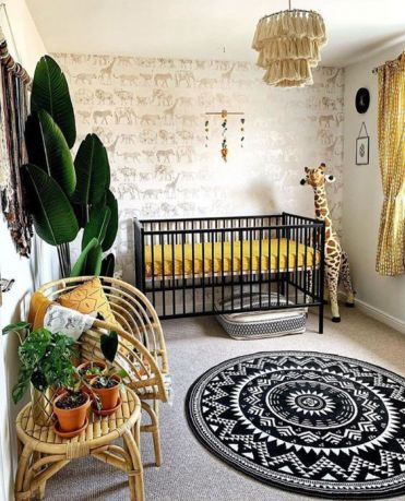 A-super-bold-safari-nursery-with-an-animal-print-wall-a-black-crib-with-mustard-bedding-a-tassel-chandelier-rattan-furniture-and-potted-plants-plus-a-printed-rug