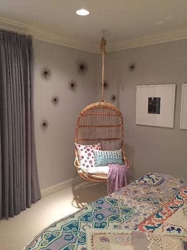 Girl-bedroom-corner-hanging-rattan-chair