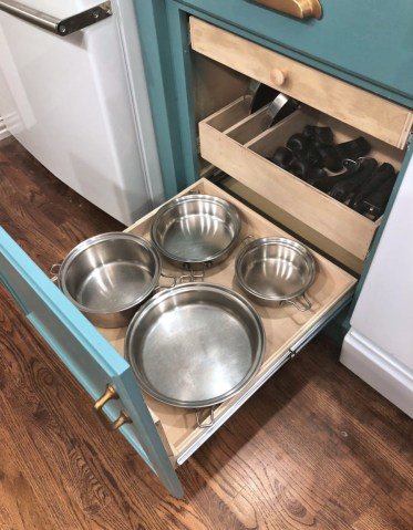 Organized-and-customized-pul-out-shelf-for-cookware-lower-shelf-with-four-most-used-pots-and-pans