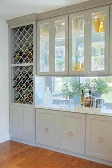 Stacked-wine-racks-see-through-cabinets-gray-bar-design-window-backsplash