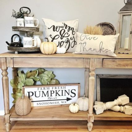 02-a-neutral-fall-console-table-with-white-natural-and-faux-pumpkins-wheat-leaves-and-printed-pillows