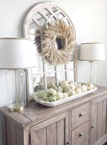 03-a-farmhouse-buffet-with-a-corn-husk-wreath-over-the-table-and-a-tray-with-white-and-green-pumpkins-plus-moss