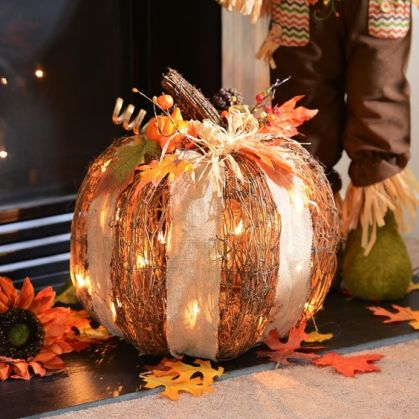 04-cute-rattan-pumpkins-with-white-lights-and-a-burlap-bow