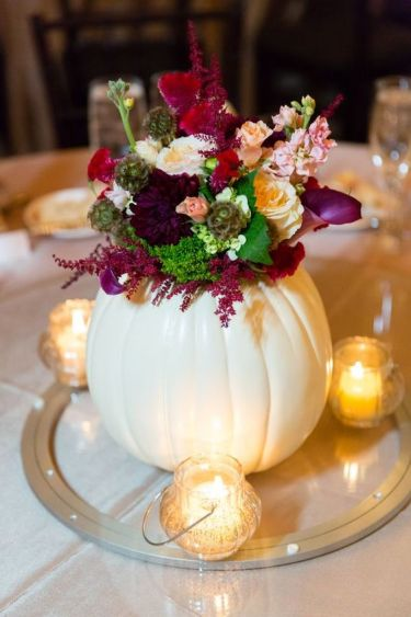 04-pumpkin-used-as-a-vase-for-a-fall-wedding-centerpiece