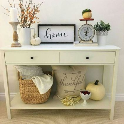 05-simple-fall-styling-with-a-couple-of-pumpkins-berries-greenery-and-a-basket-with-blankets
