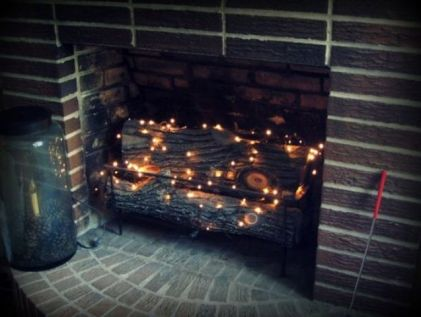 06-put-firewood-and-then-add-a-string-or-two-of-twinkle-lights-in-the-fireplace-to-add-a-soft-glow-to-the-room
