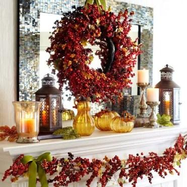 07-glass-pumpkins-berry-wreath-leaf-garland-candles