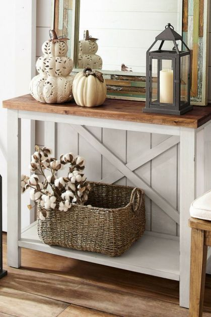 08-a-vintage-rustic-console-with-laser-cut-pumpkins-and-a-porcelain-one-a-candle-lantern-and-a-basket-with-cotton-branches